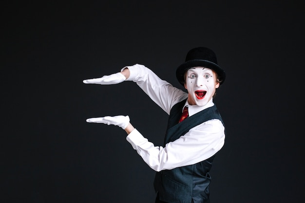 Mime holds his palms parallel in the air Free Photo