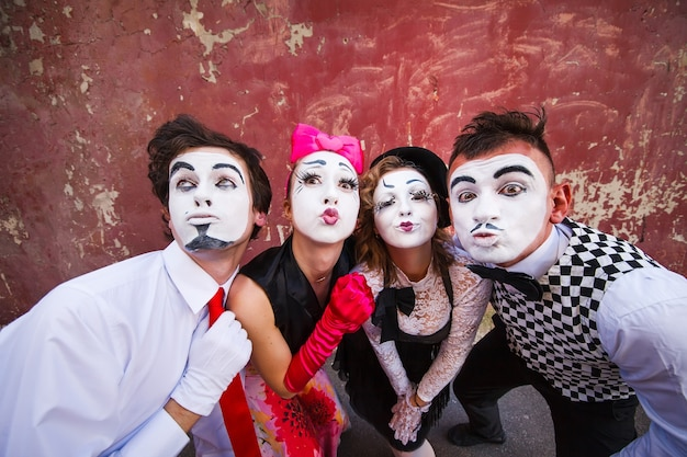 Mimes standing on a red wall Premium Photo