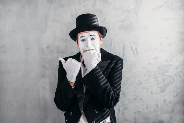 Mimic male person with white makeup mask. Premium Photo