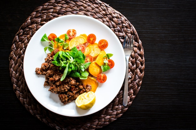 Minced beef with roasted sweet potatoes and side salad Free Photo
