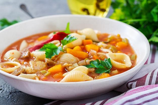 Minestrone, italian vegetable soup with pasta on  table. vegan food Premium Photo