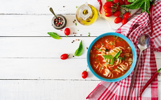 Minestrone, italian vegetable soup with pasta. tomatoes soup. vegan food. top view. flat lay. Free Photo