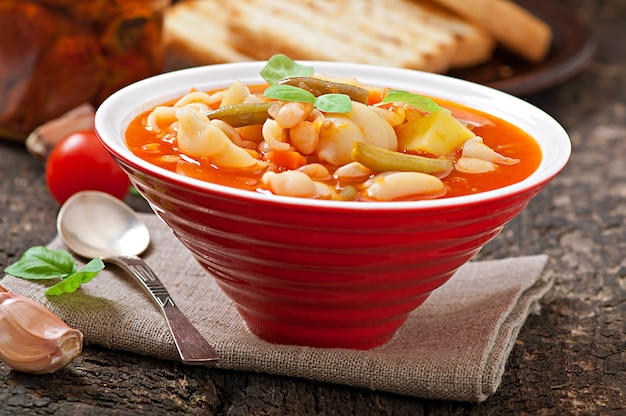 Minestrone, italian vegetable soup with pasta Premium Photo