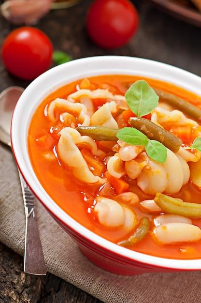 Minestrone, italian vegetable soup with pasta Premium Photo