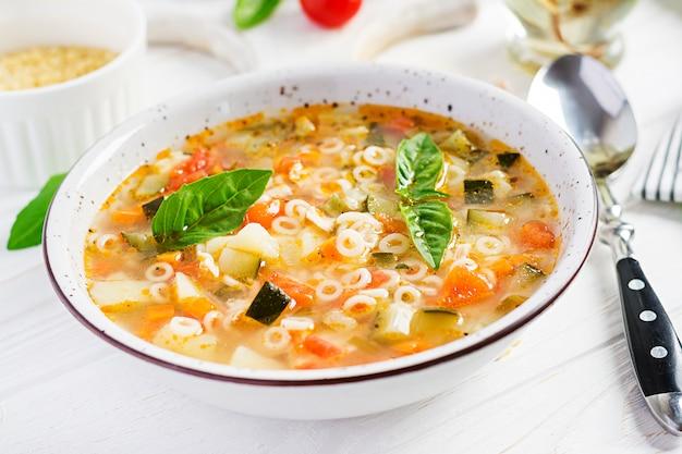 Minestrone vegetable soup with pasta Premium Photo