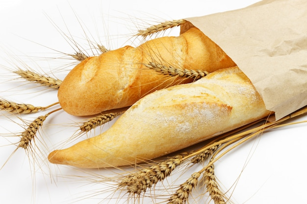 Mini baguettes in pacage with wheat Premium Photo