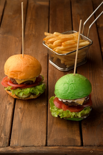 Mini cheeseburgers and crispy fries Free Photo