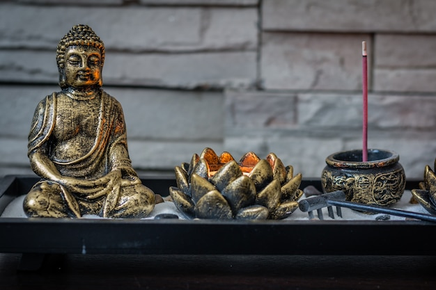 Mini Desk Zen Garden With Lit Candle And Small Buddha In It Photo