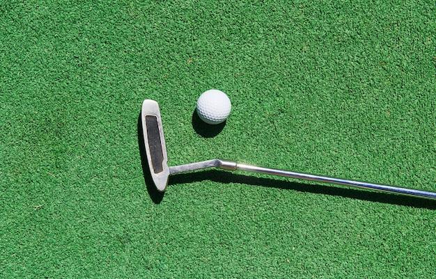 Mini-golf ball on artificial grass. summer season game Free Photo
