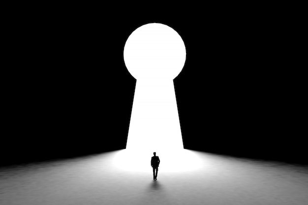 Miniature businessman standing in front of wall with key hole door background Premium Photo