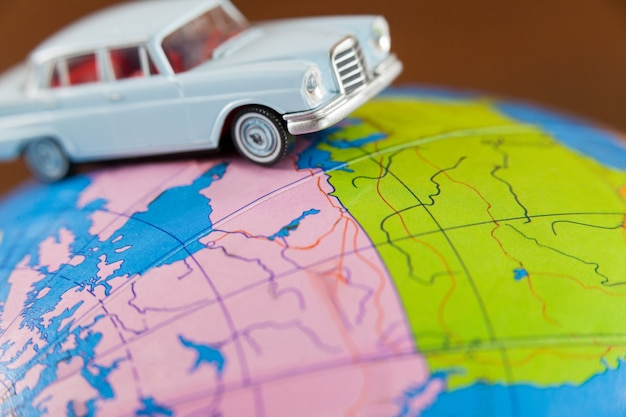 Miniature car on a map Free Photo