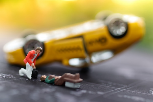 Miniature emergency medical to help people car accident. Premium Photo