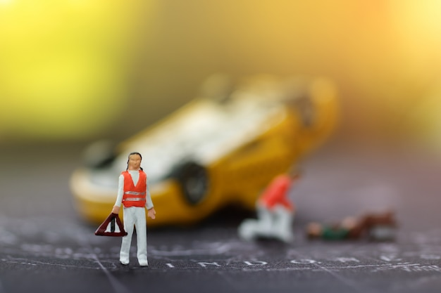 Miniature emergency medical team to help people car accident. Premium Photo