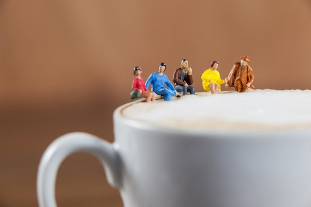 Miniature group of friends having coffee Free Photo