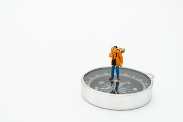 Miniature man stand on the walkway the beginning of the journey to reach the goal. Premium Photo