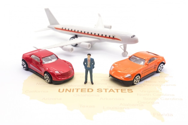 Miniature people, businessman and car airplane on map american Premium Photo
