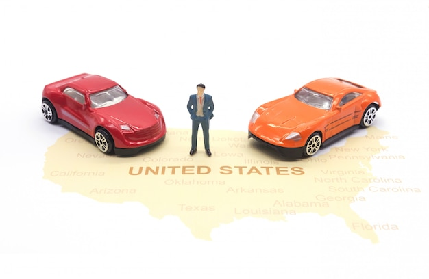 Miniature people, businessman and car on map american Premium Photo