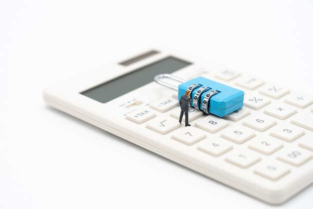 Miniature people businessmen analyze password from the blue key as background business concept Premium Photo