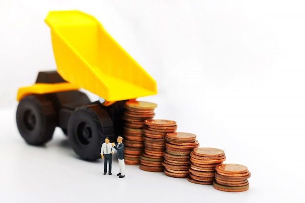 Miniature people:  businessmen standing with coins stack, finance, investment and growth in business concept. Premium Photo