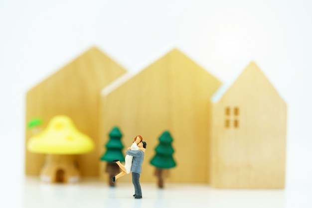 Miniature of people lover standing with house Premium Photo