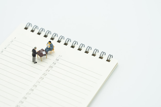 Miniature people sitting consulting advisory services to pay taxes business Premium Photo