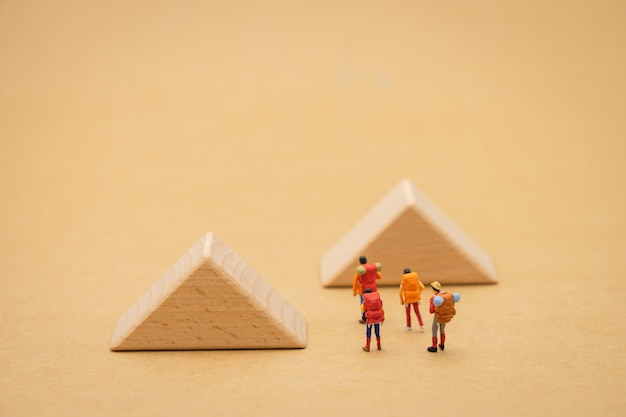 Miniature people stand on the walkway is a block means the beginning of the journey Premium Photo