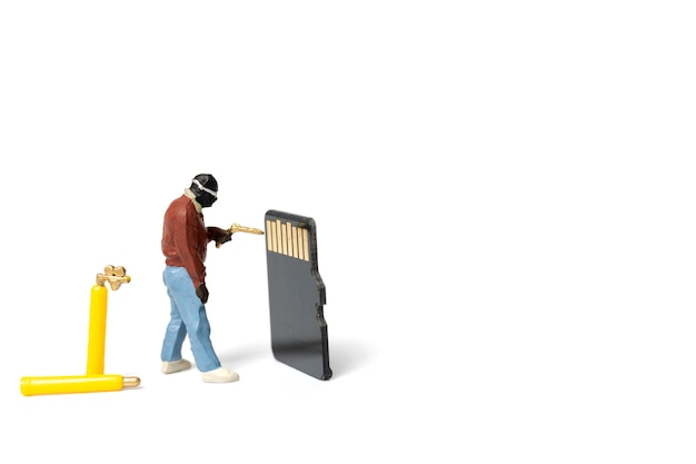 Miniature people technician fixing pile of sd cards on white background Premium Photo