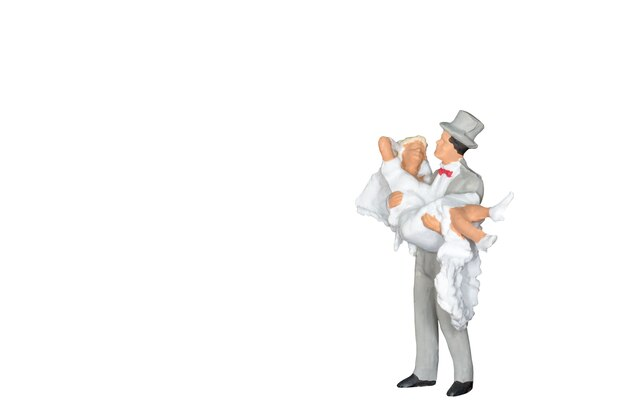Miniature people : wedding bride and groom isolated on white Premium Photo