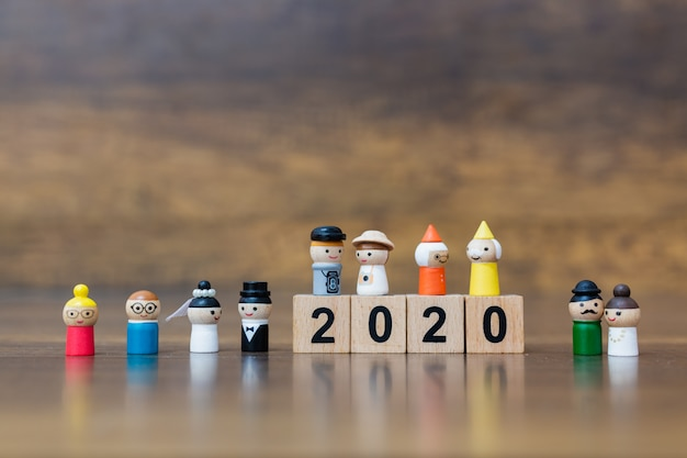 Miniature toy : wooden doll with  wooden block number 2020 Premium Photo