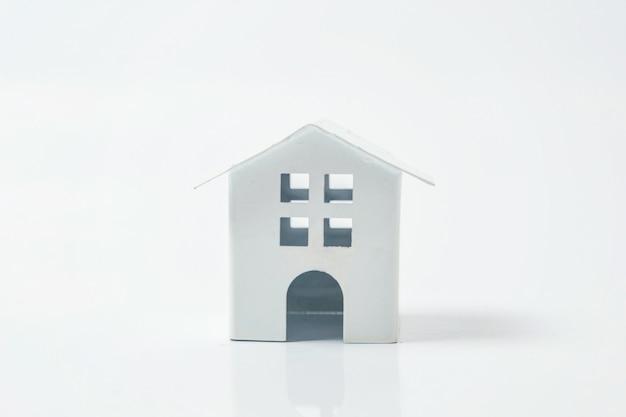 Miniature white toy house on white background Premium Photo