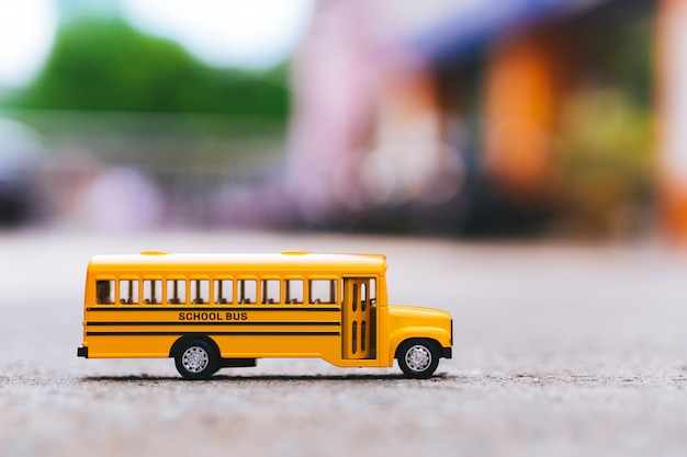 Miniature of yellow school bus on the road Premium Photo