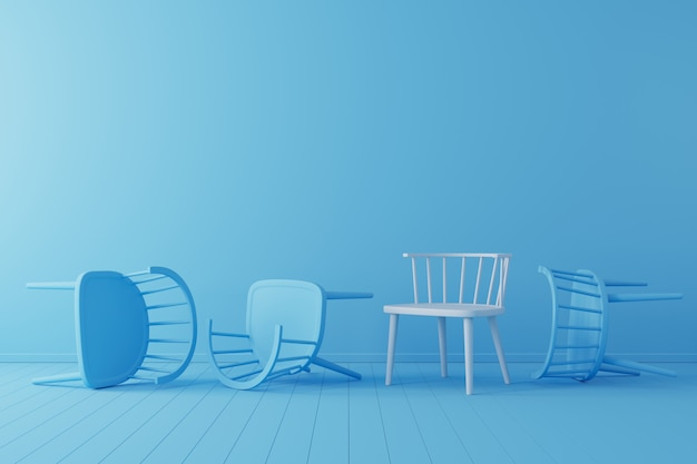Minimal concept. outstanding white chair with falling blue chair on blue floor and background. Premium Photo