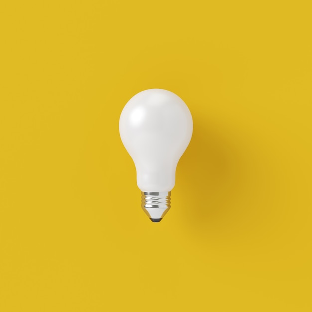 Minimal concept. outstanding white light bulb on yellow background Premium Photo