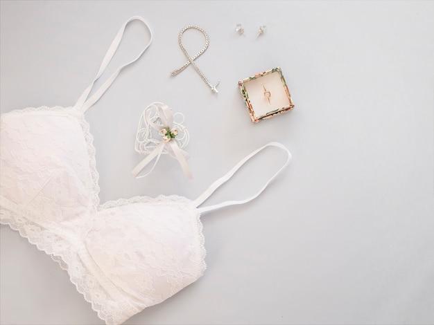 Minimal flat lay with wedding accessories on light background. Premium Photo