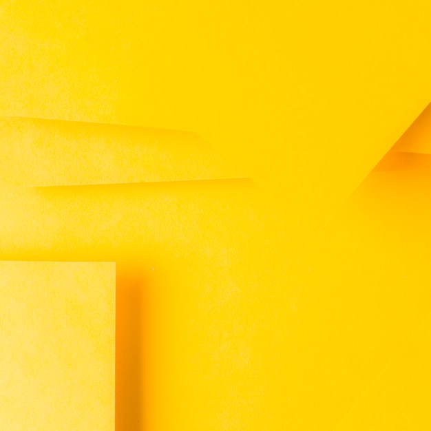 Minimal geometric shapes and lines on yellow paper Free Photo