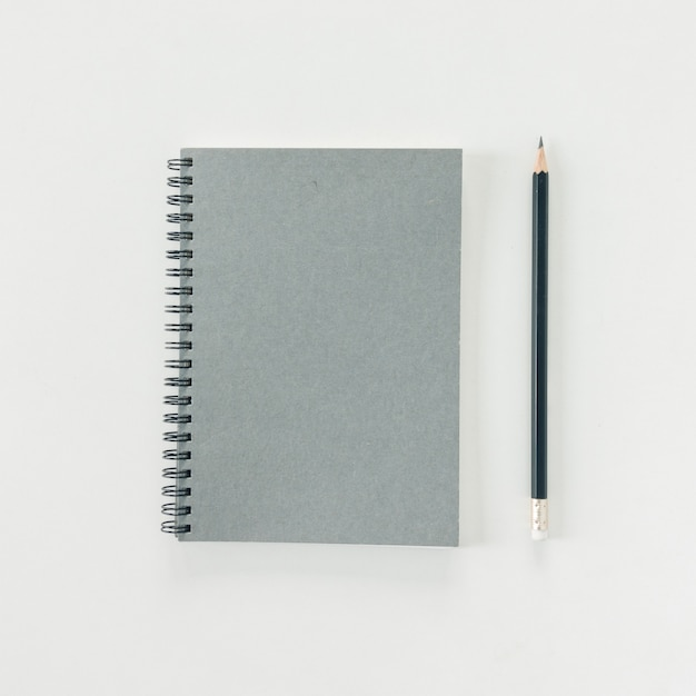 Minimal work space - creative flat lay photo of workspace desk with sketchbook and wooden pencil on copy space white background. top view , flat lay photography. Free Photo