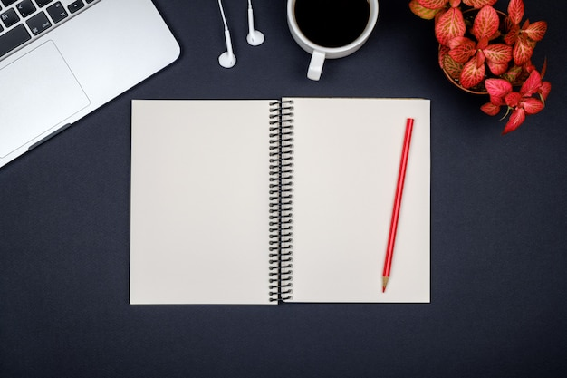 Minimal workplace with laptop and blank notepad Premium Photo