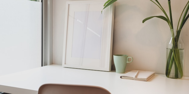 Minimal workplace with mock up frame and copy space Premium Photo