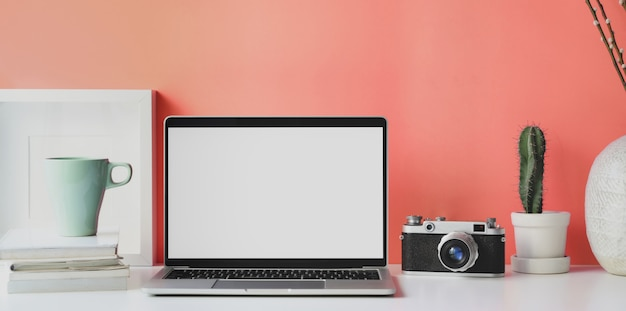 Minimal workplace with open blank screen laptop Premium Photo