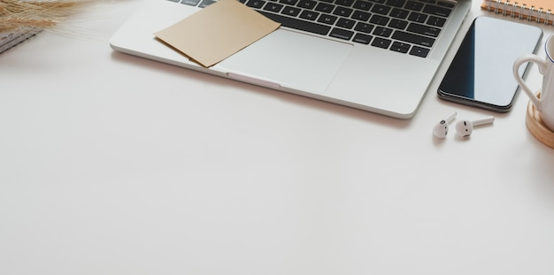 Minimal workplace with open laptop with office supplies and copy space Premium Photo