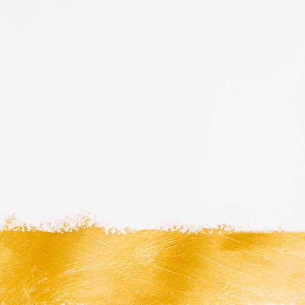 シンプルなゴールドペイントと白の背景 無料写真