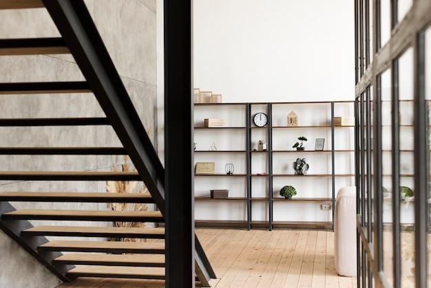 Minimalist modern book shelf and stairs Free Photo