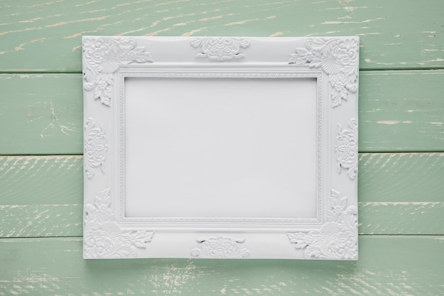 Minimalist ornamental frame on wooden background Free Photo