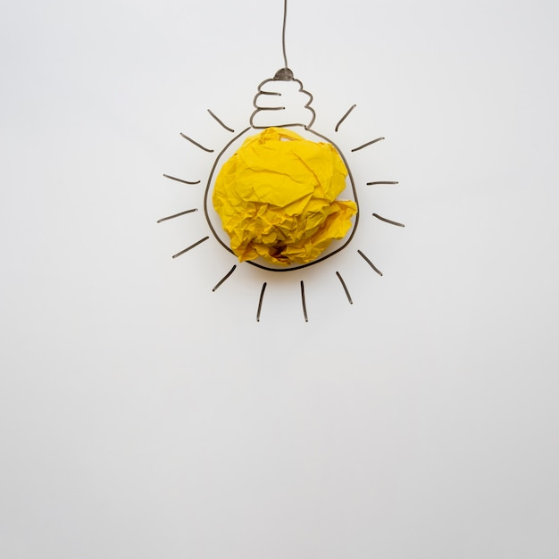 Minimalist paper light bulb with copy space Free Photo