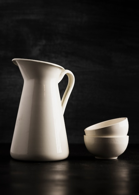 Minimalist small white cups and jug Free Photo