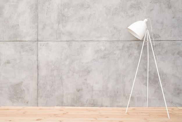 Minimalist white floor lamp with concrete panels Free Photo