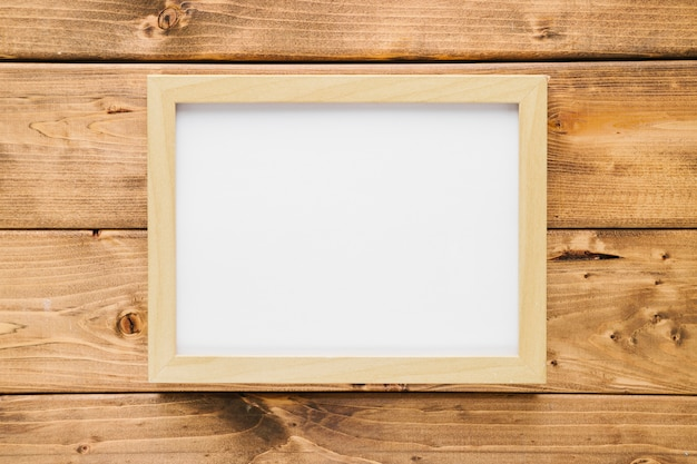 Minimalist wooden frame with wooden background Free Photo