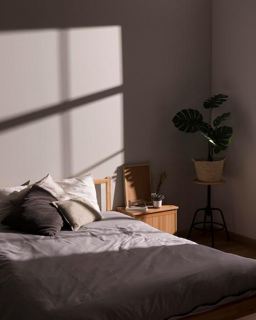 Минималистичная кровать с внутренним растением Бесплатные Фотографии