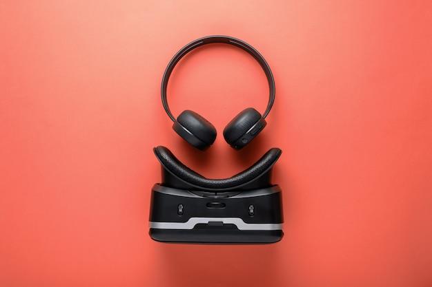 Minimalistic design gadgets, wireless headphones and vr glasses Premium Photo
