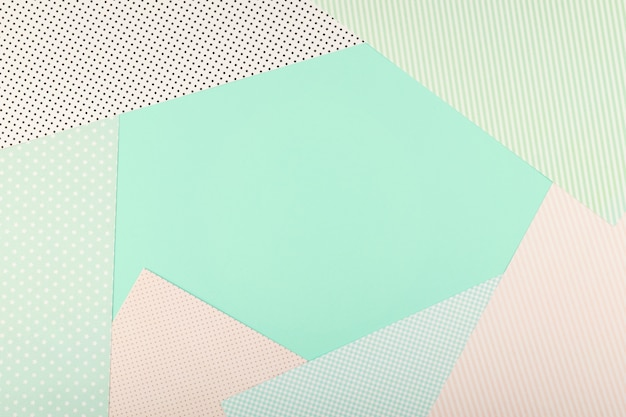 Mint blue and pink pastel color paper geometric flat lay background. Premium Photo